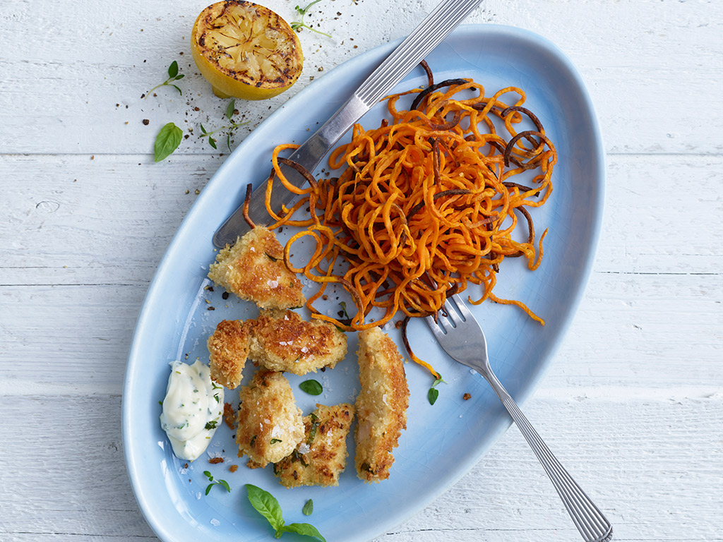 Top 10 meals to make for picky eaters - Herby Chicken Nuggets with Spiralized Sweet Potato Curls Recipe by Annabel Karmel