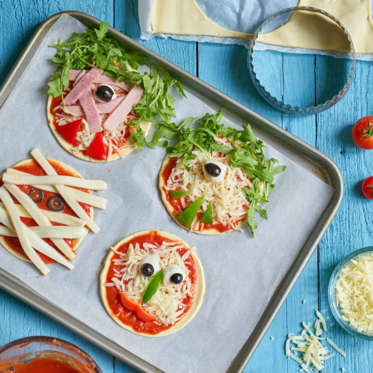 Monster and mummy pizzas recipe by Annabel Karmel