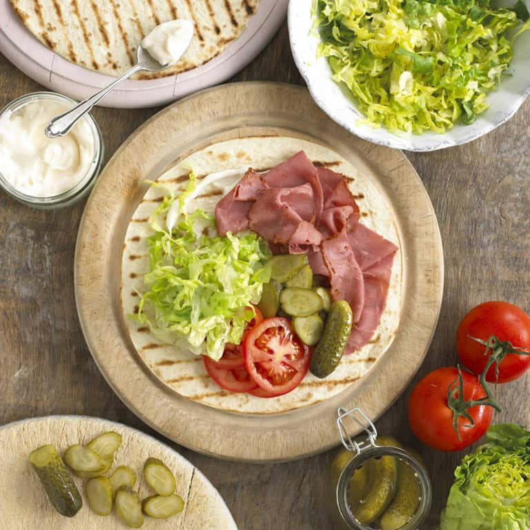 Pastrami, Dill Pickle & Tomato Wrap recipe by Annabel Karmel
